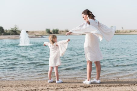 amal-al-raisi-oman-fashion-designer-middle-east-local-style-matching-mini-me-twinning-mum-daughter-gingham-and-sparkle-cream-lace-embellishment-teal-colour-stunning-girls-mini-fashionista-blogger-ootd-wings-sleeves-trend-spring-summer-dubai-uae-al-qudra-desert-lakes-sand-fly-love-family